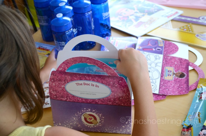 packing Doc McStuffins party bags