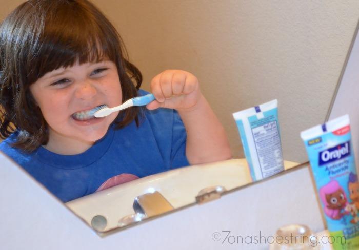 teach proper brushing