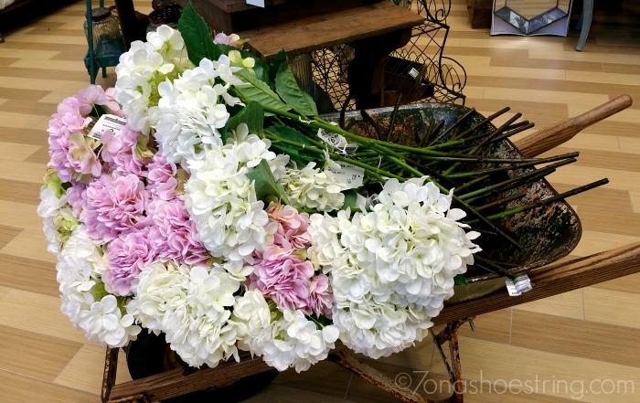 Nebraska Furniture flowers in wheelbarrow