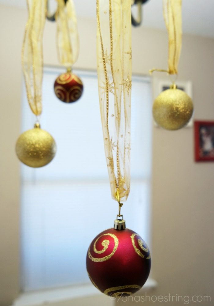 hang Christmas ball ornaments from ribbon