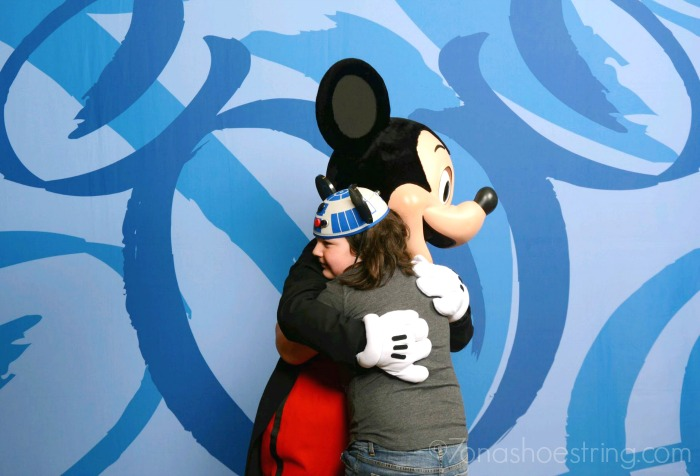 hugging Mickey Mouse at Walt Disney World