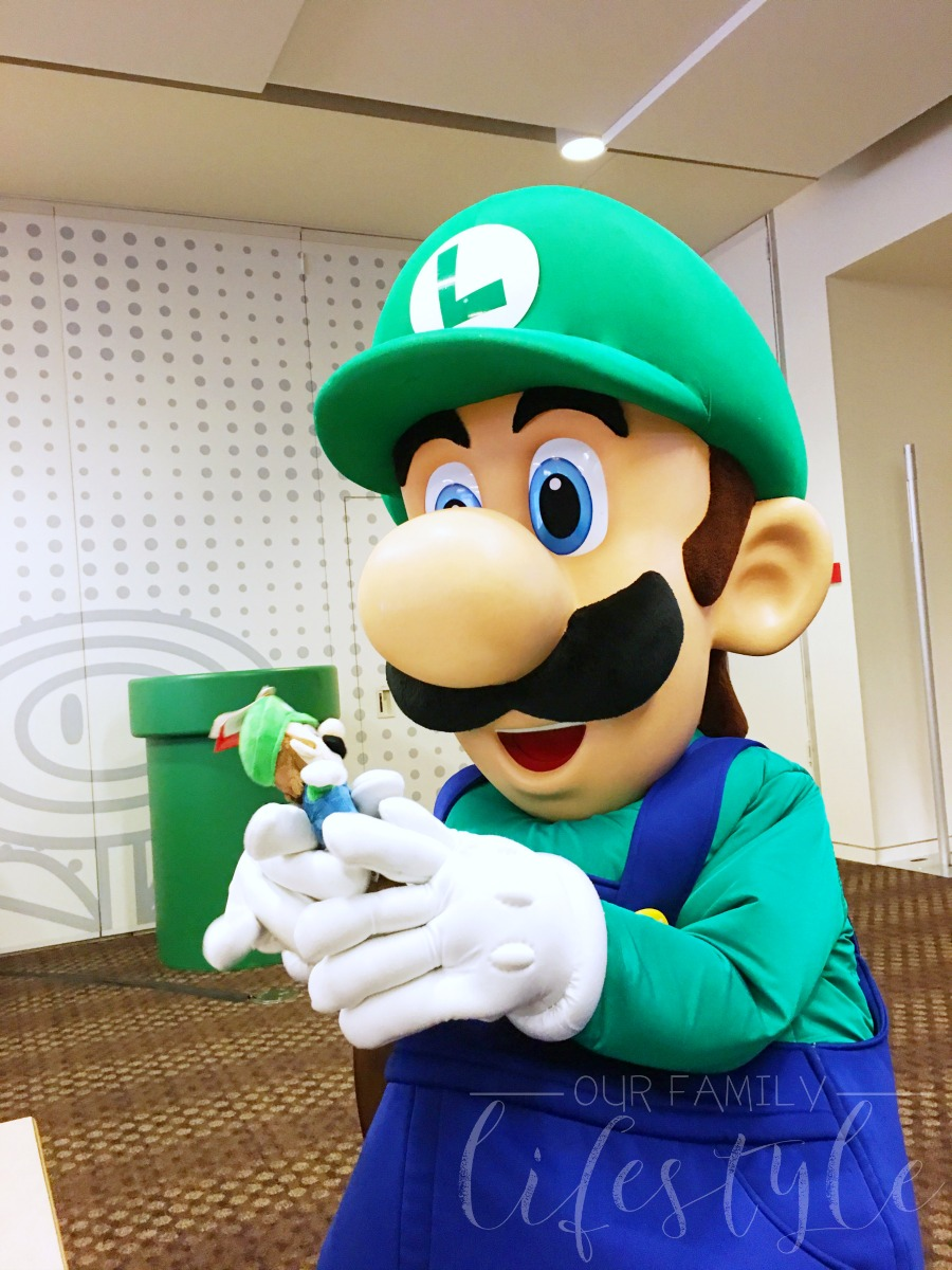 Luigi with a stuffed Luigi