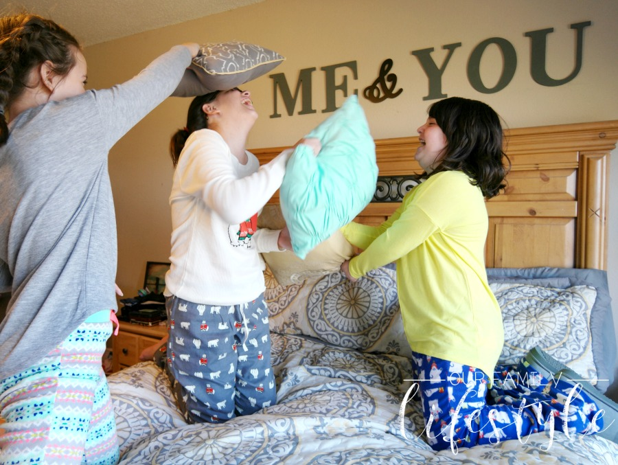 pillow fight in matching family pajamas