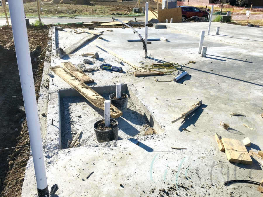 pouring the concrete for house foundation
