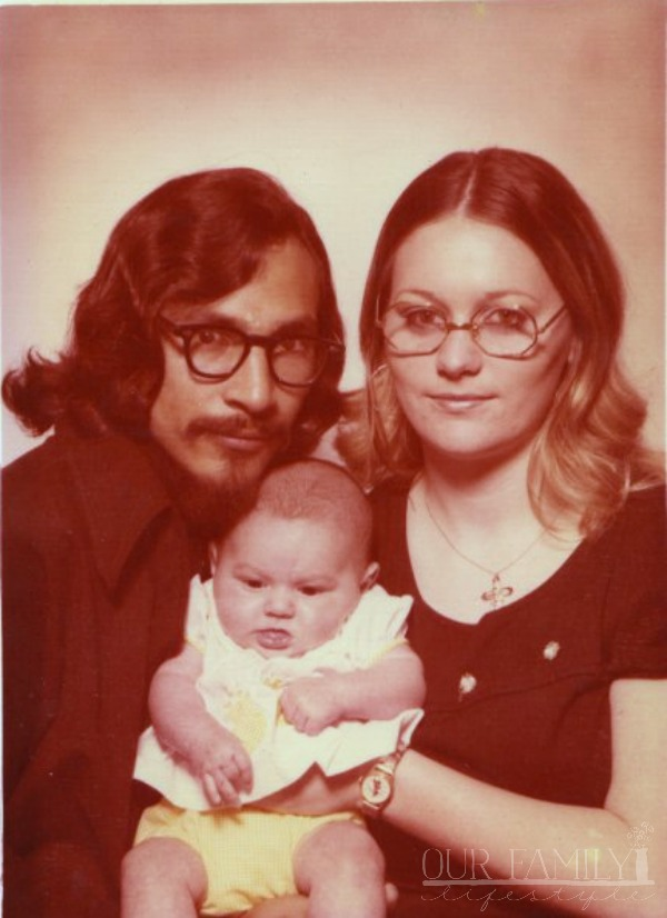 mom and dad with me as a baby