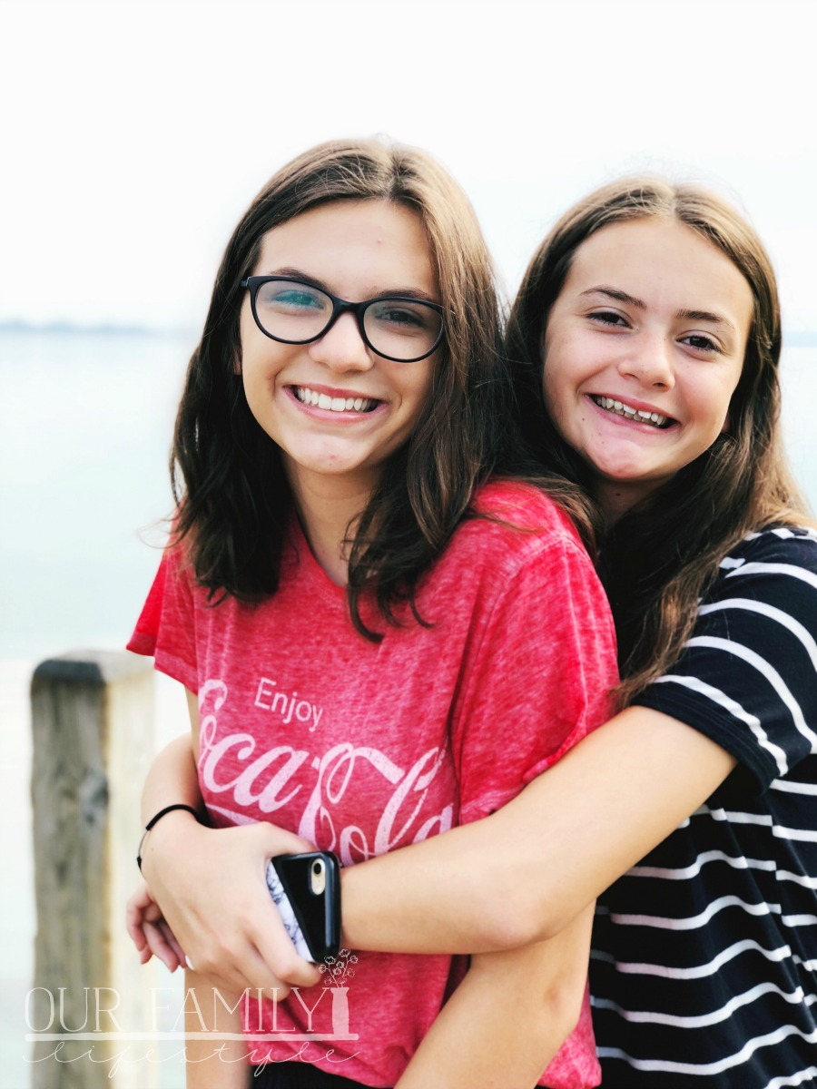 sisters lift each other up in support