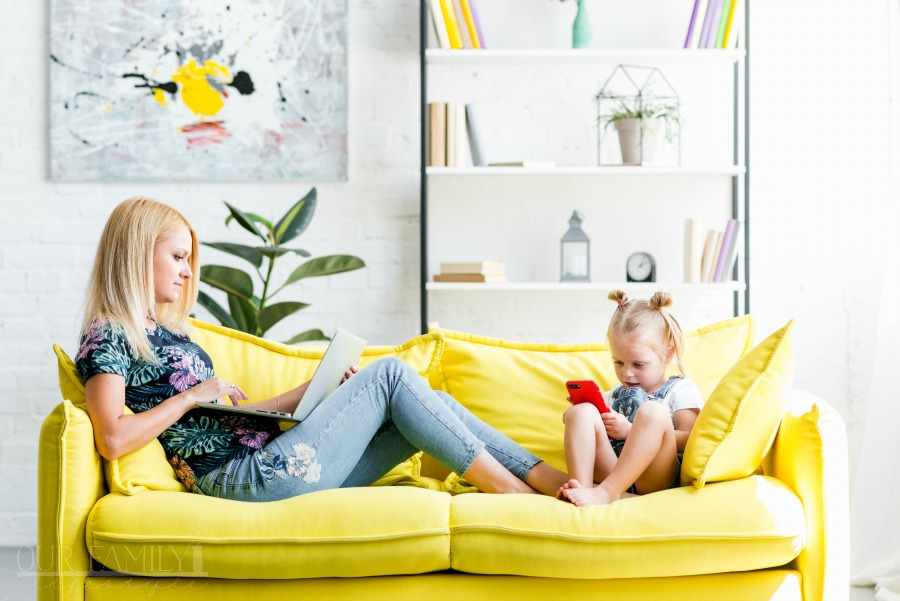 working mom on couch with child