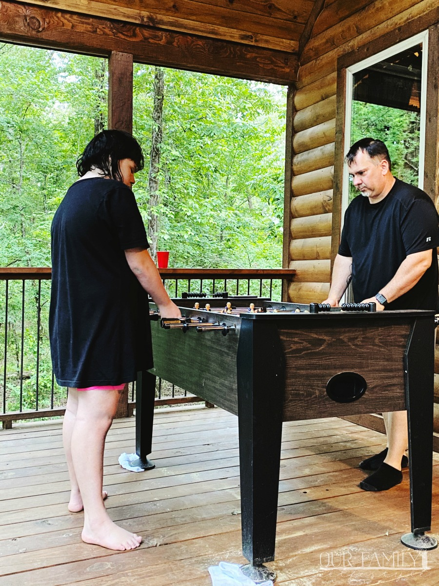 Colby and Joeli playing foosball