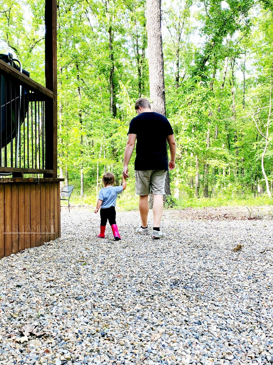 Nic and Riley walking in the woods