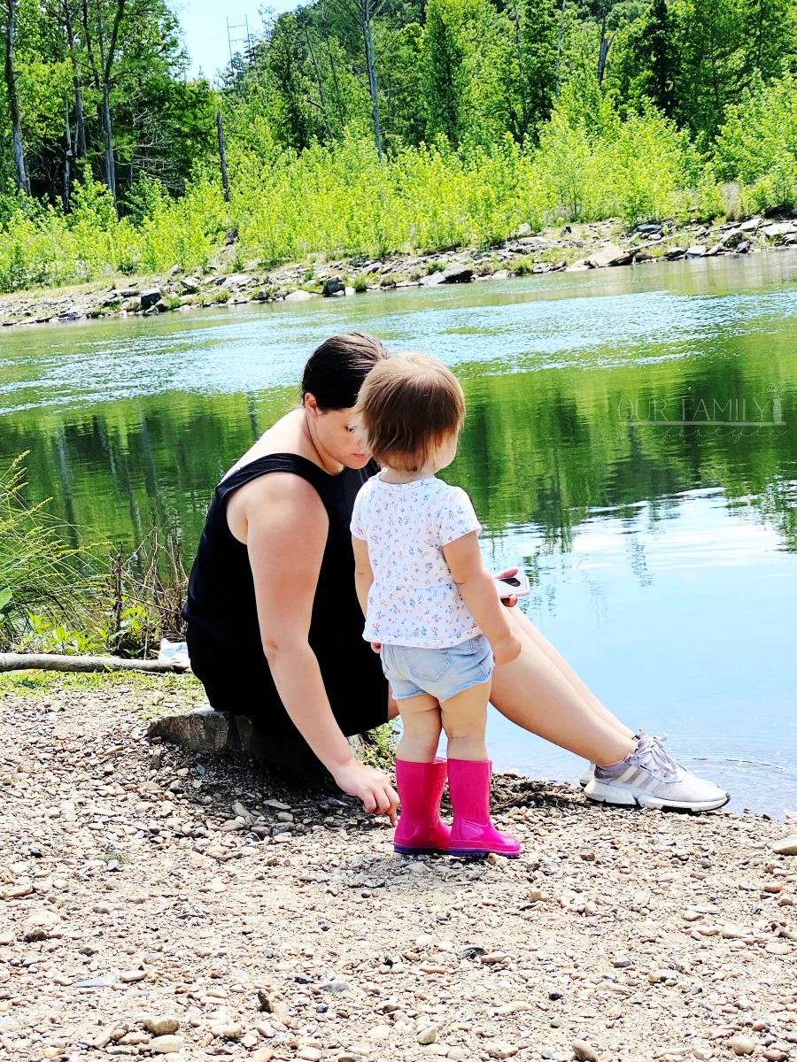 mom and toddler by the river