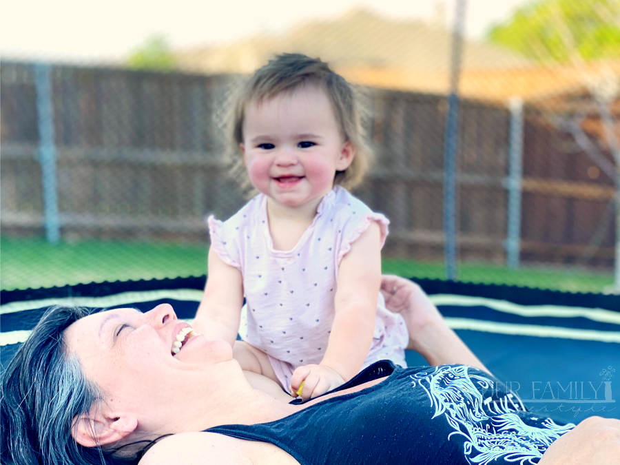 playing with grandma on the trampoline