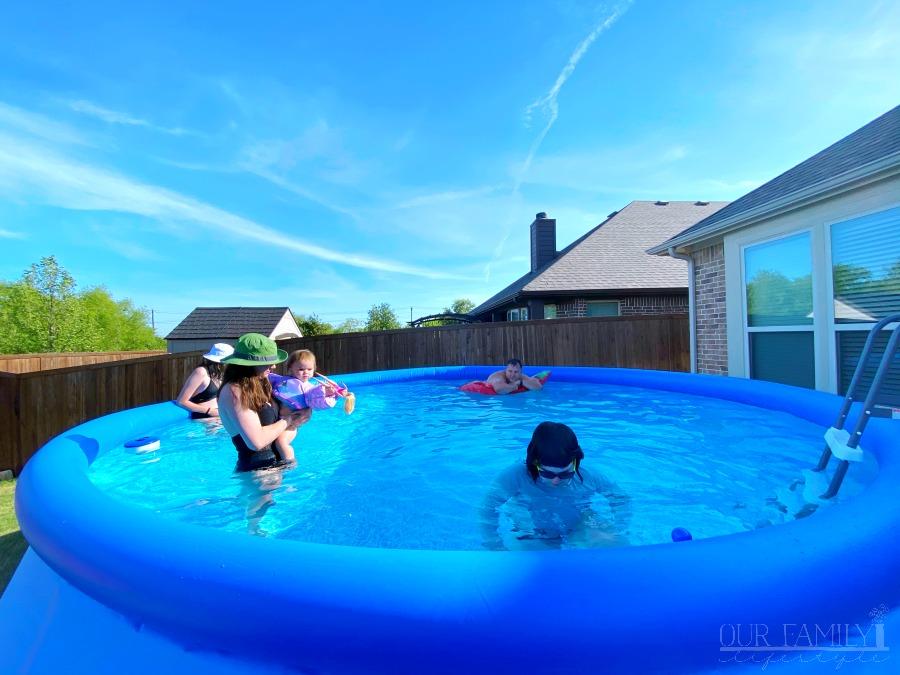 swimming in new backyard pool