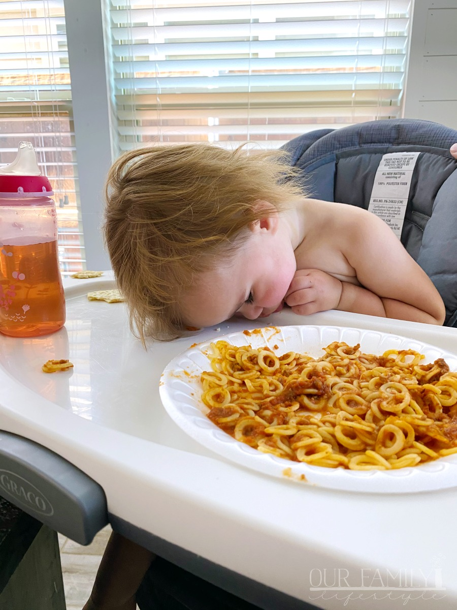 toddler asleep at dinner