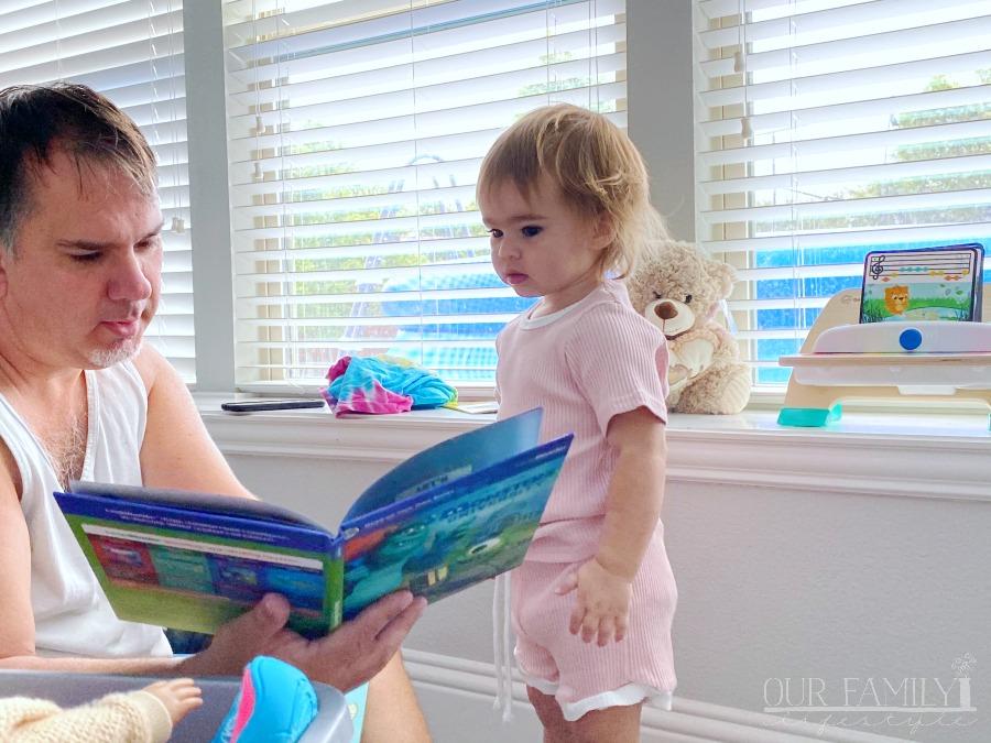 grandpa reading to granddaughter
