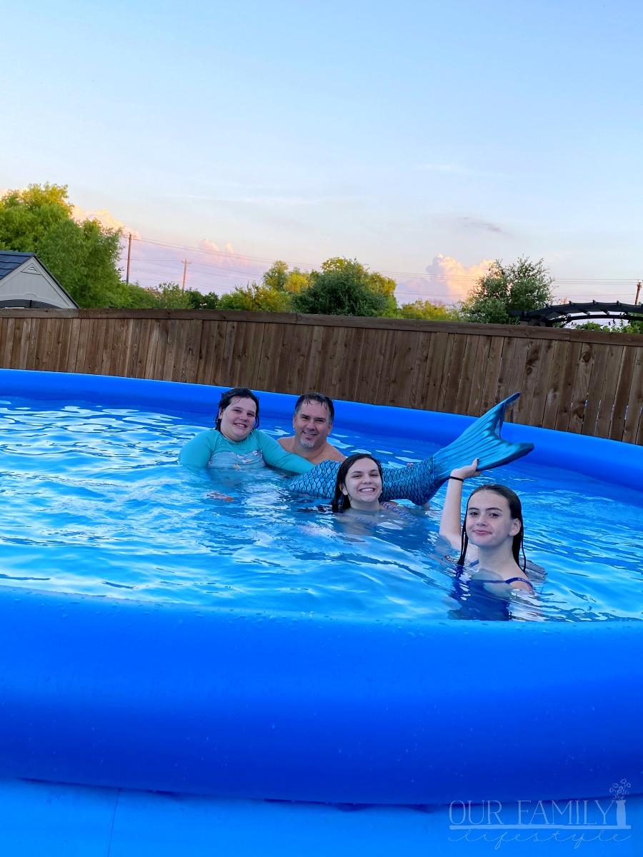 mermaid tail in the backyard pool