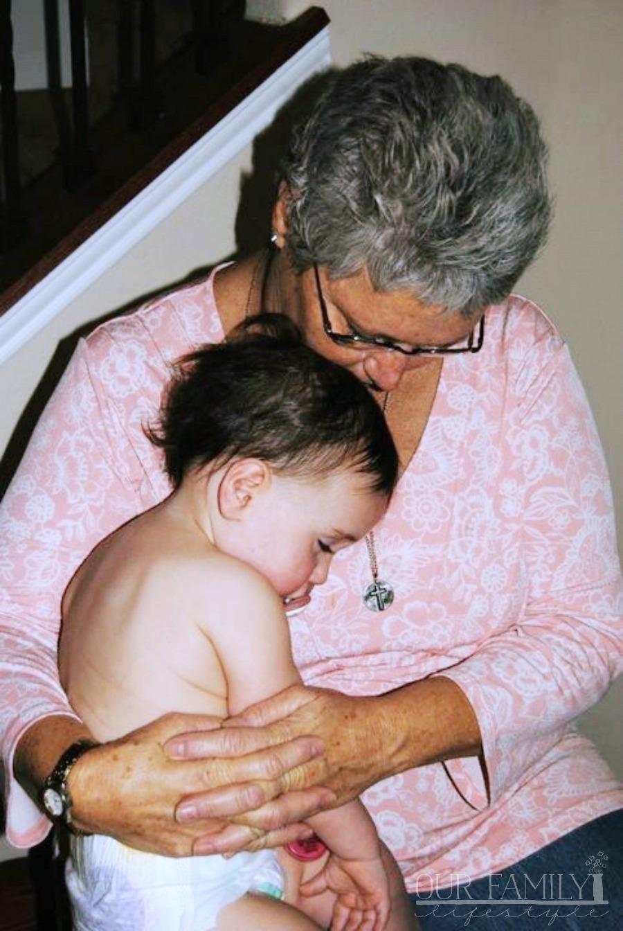 mom holding baby Joeli