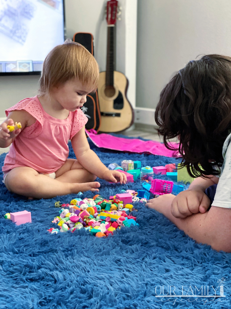 niece and aunt playing shopkins
