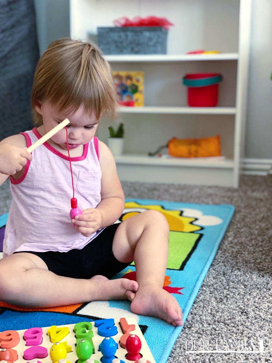 toddler playing fishing game