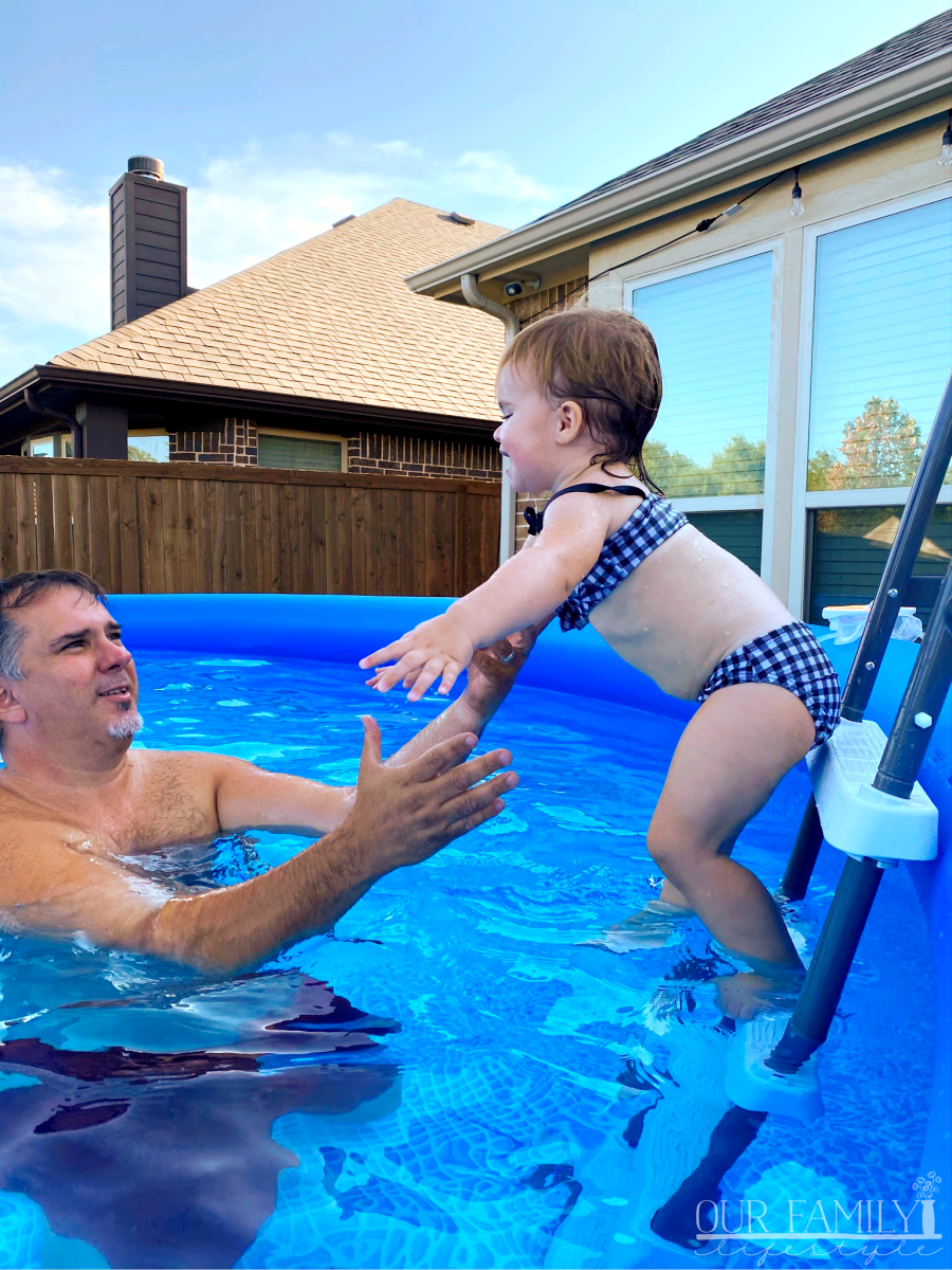 toddler jumping to grandpa in pool