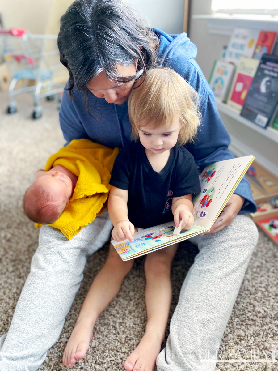grandmother reading to two granddaughters
