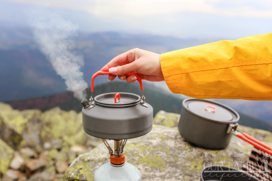 camping teapot with mountain view
