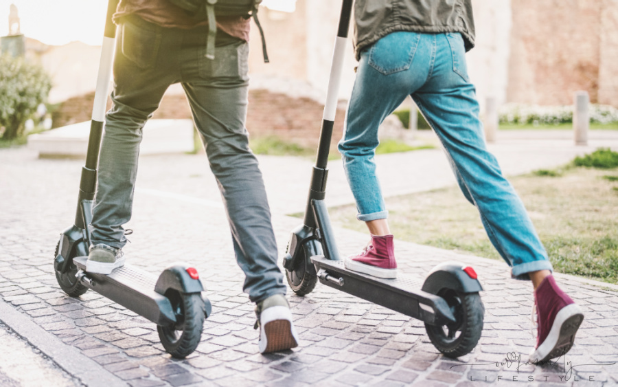 couple-using-electric-scooter-at-park