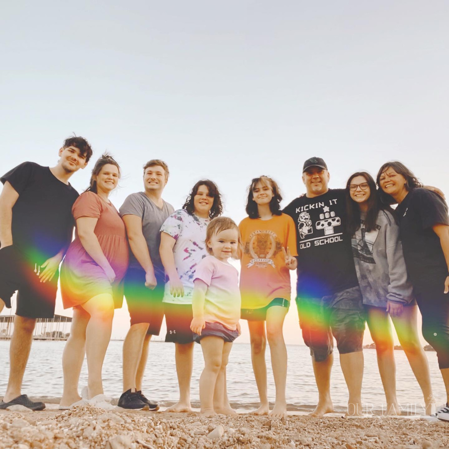 rainbow wave over family at lake
