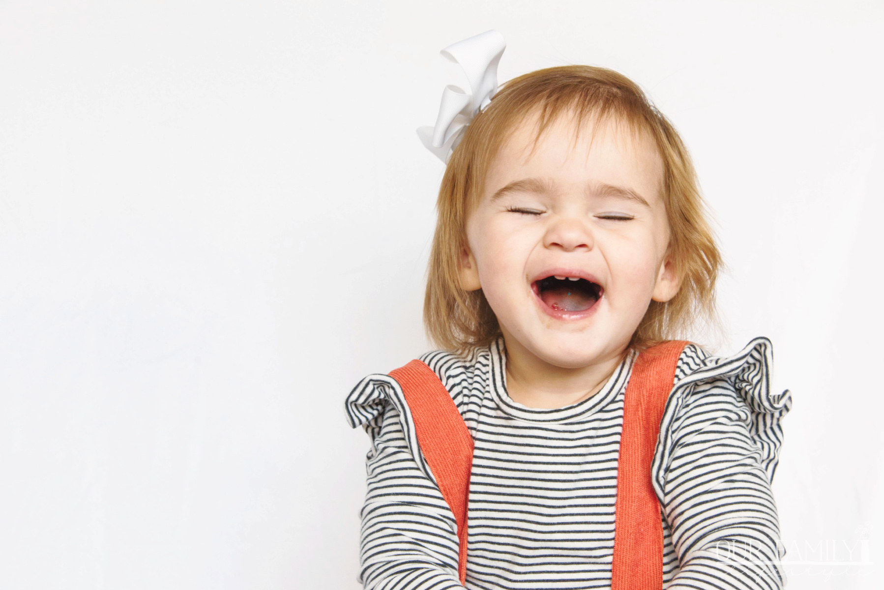 toddler granddaughter laughing with candy
