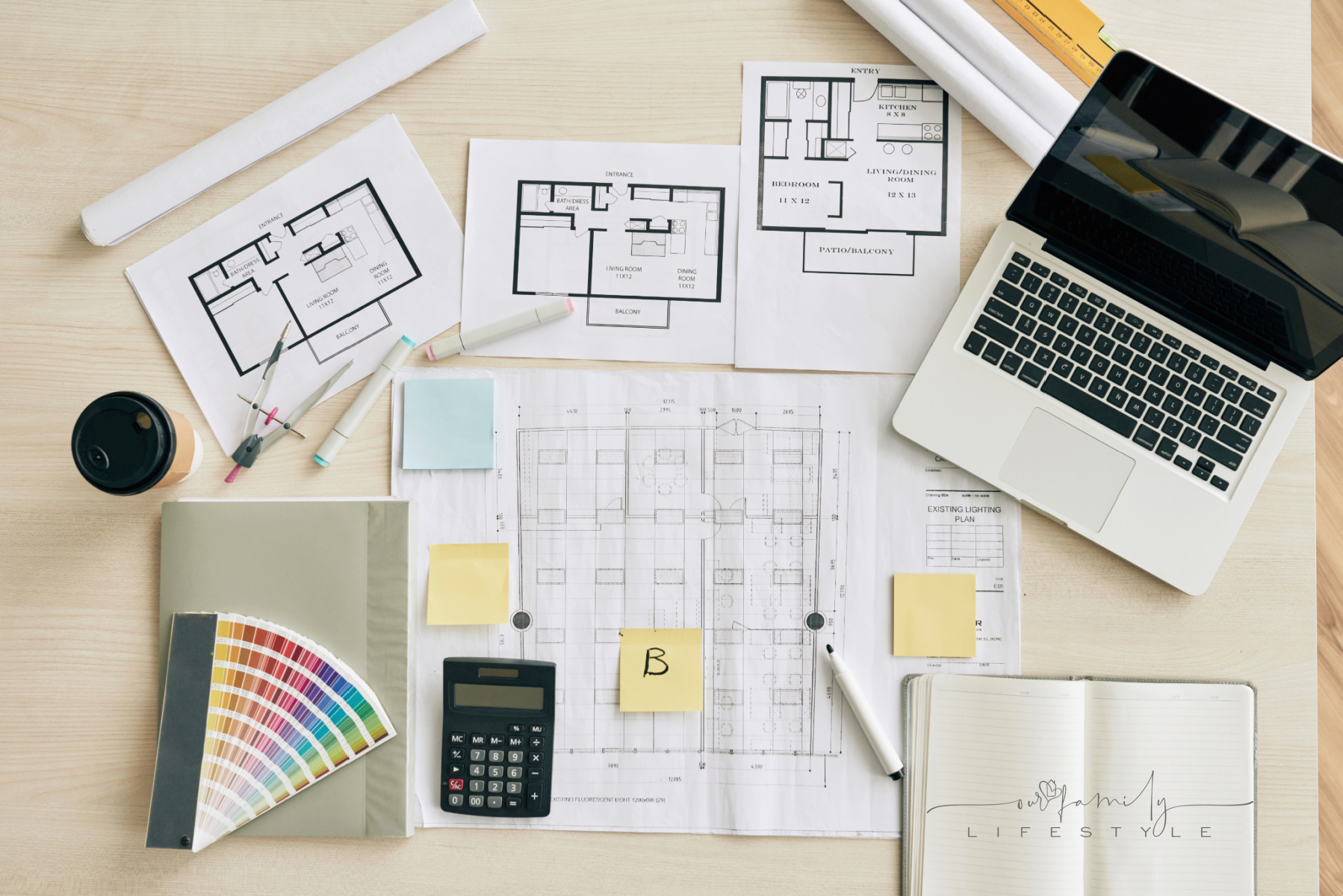 Plans and blueprints on table of interior designer, view from above