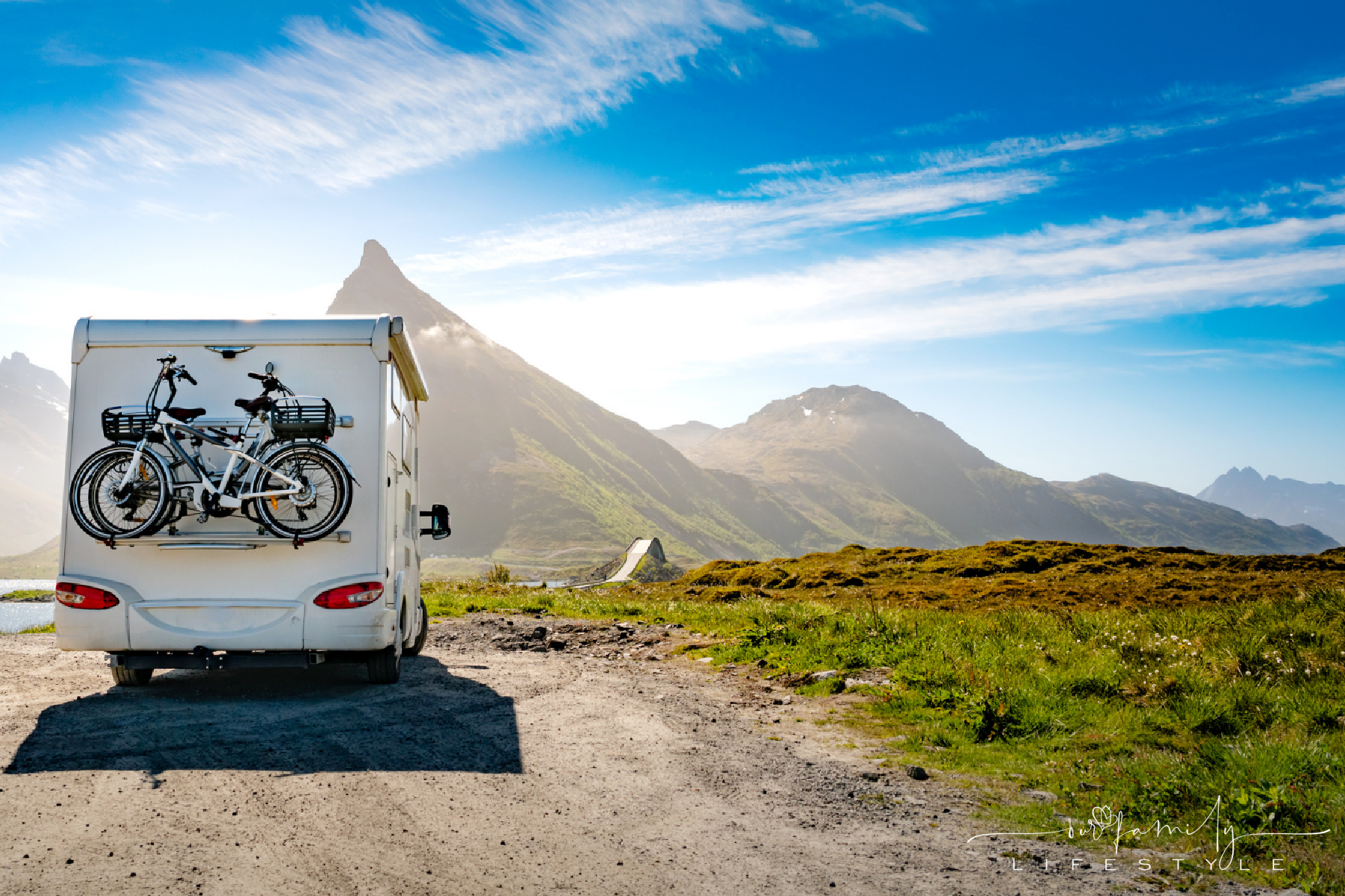 rv camper with bikes in the mountains