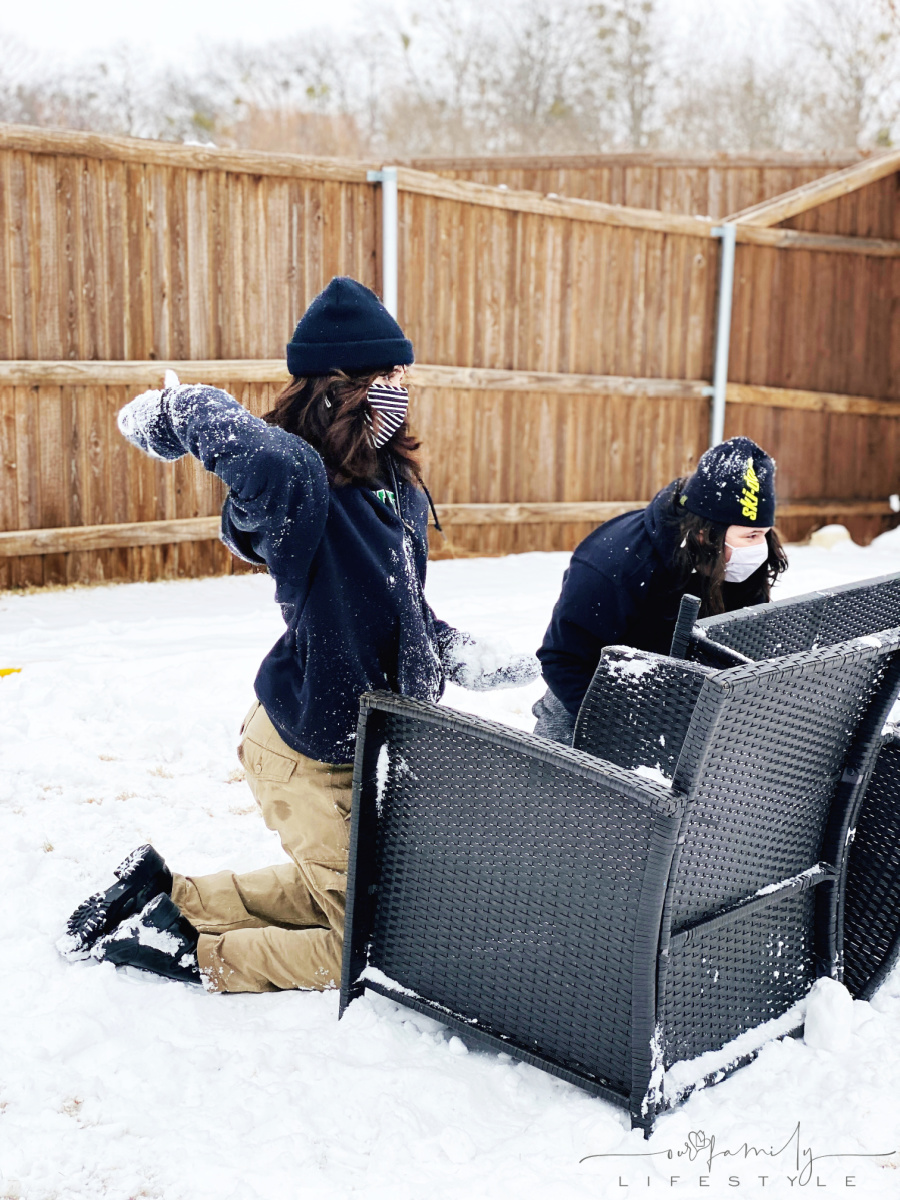 snowball fight behind patio furniture