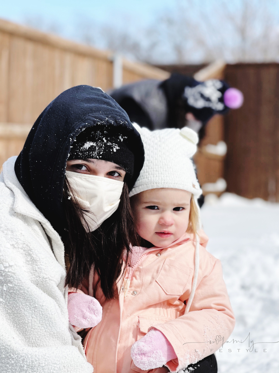 teen and toddler posing in snow