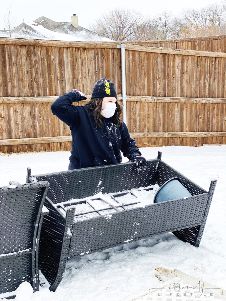 tween wearing face mask in snowball fight