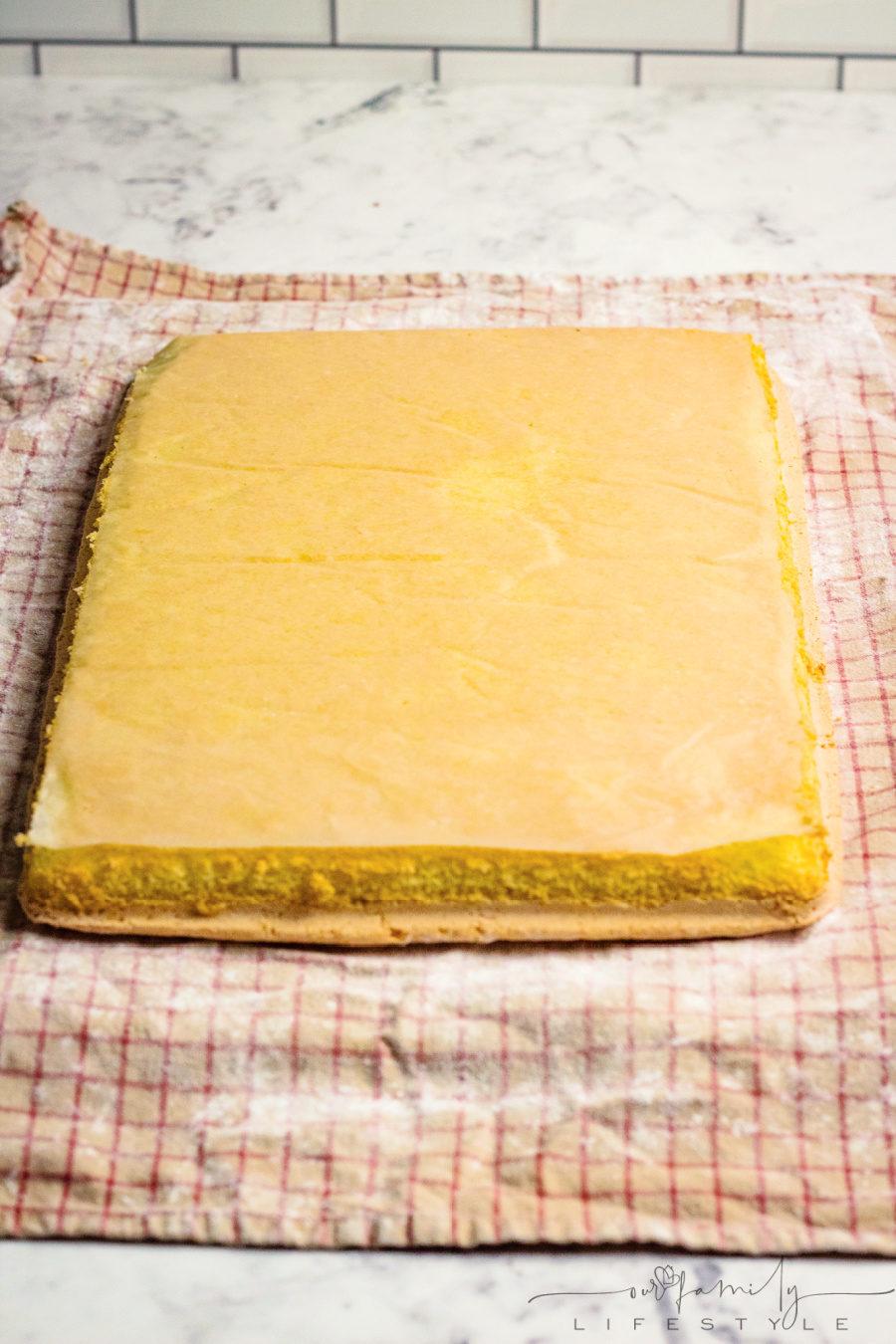 immediately turn cake roll onto dishtowel sprinkled with powdered sugar