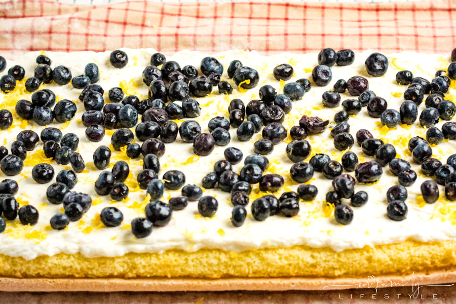 lemon filling topped with blueberries in Swiss roll