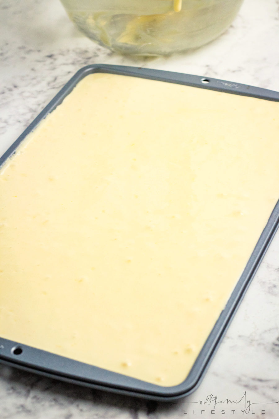 pour Swiss cake roll batter into cake pan