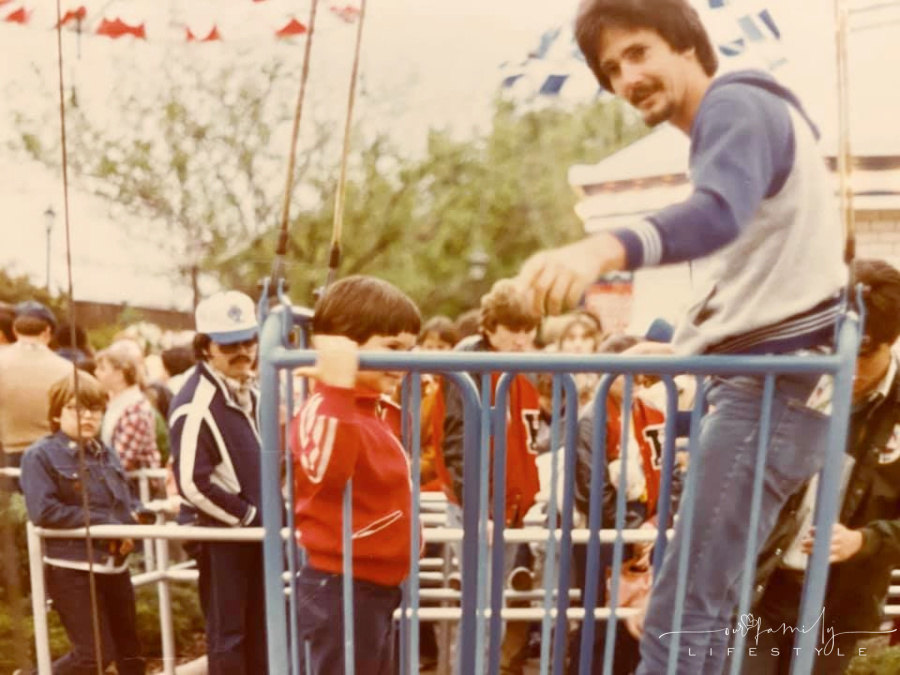 vintage photo of old theme park ride with young boy and dad in wire basket