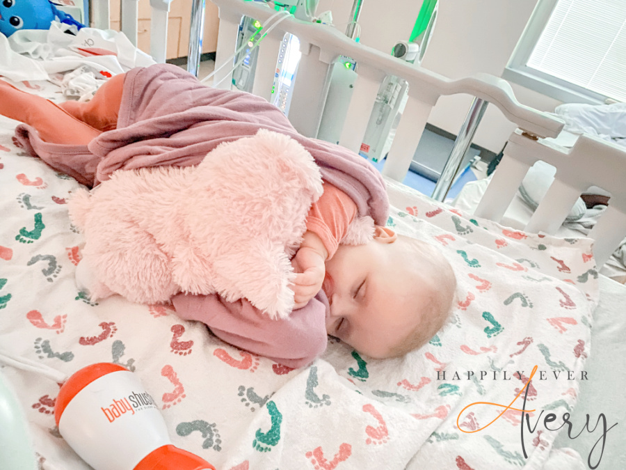 infant sleeping in hospital bed with Warmsie elephant