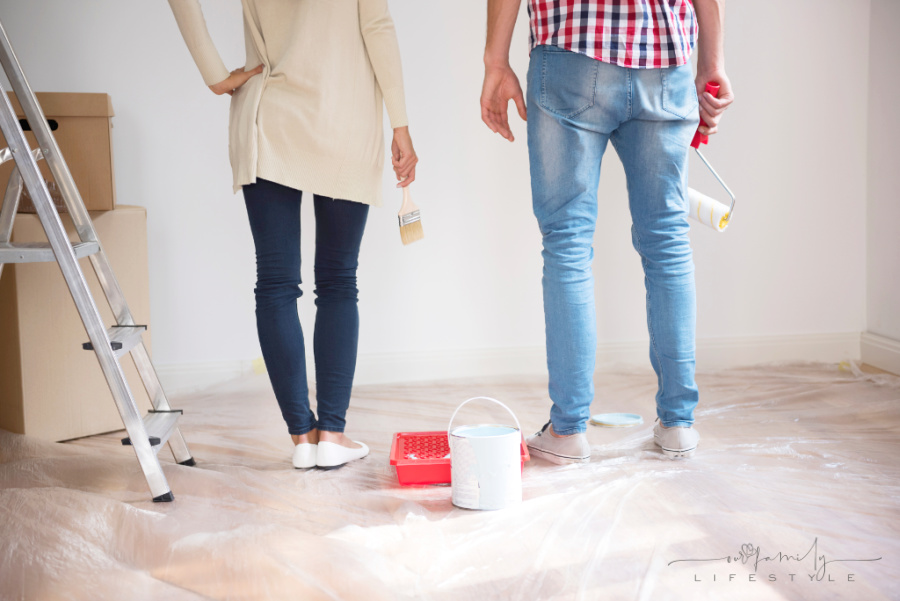 young-couple-painting-walls