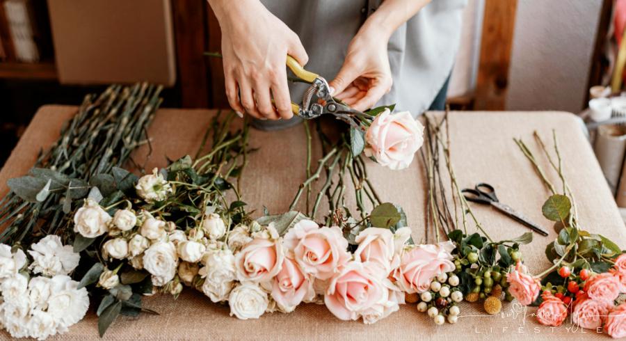florist making beautiful floral bouquet