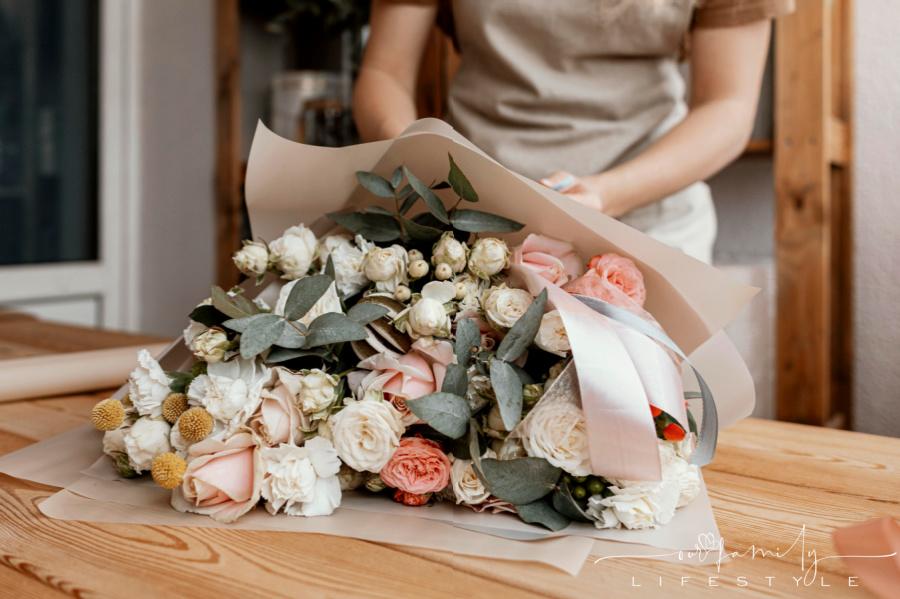 woman-making-pretty-pastel-floral-arrangement