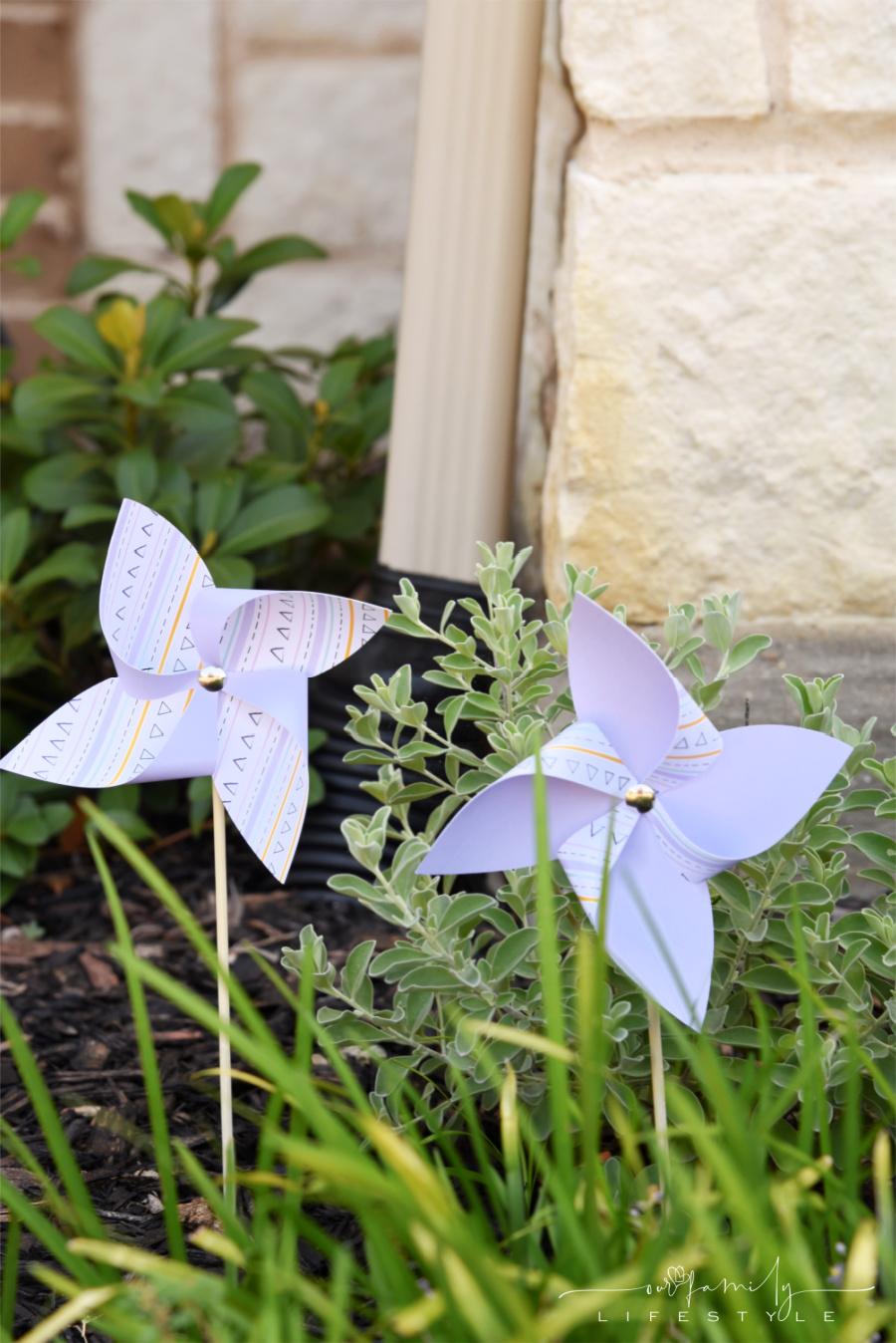DIY Cricut paper pinwheels in flower bed