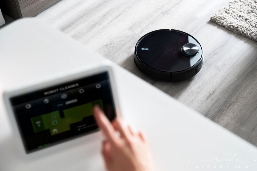 finger-activating-robot-cleaner-on-grey-floor