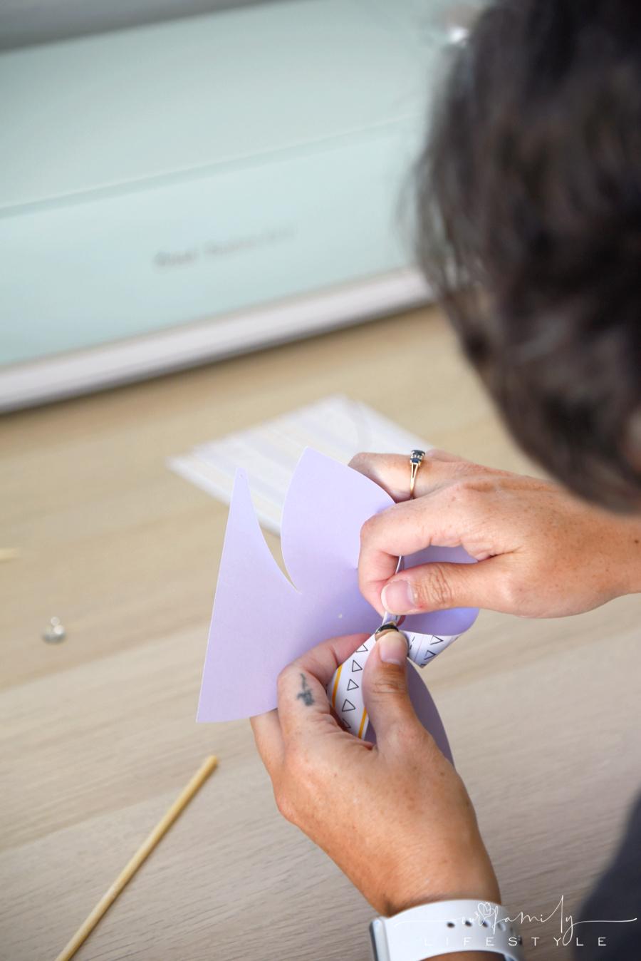 putting together a paper pinwheel